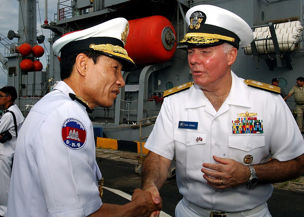 US Navy 111020-N-NJ145-140 Royal Cambodian Navy Vice Adm. Ouk Seyha thanks U.S. Navy Rear Adm. Tom Carney, commander of Task Force 73, after tourin