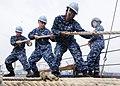 US Navy 111105-N-WJ771-007 Sailors heave around a mooring line on the forecastle of USS Germantown.jpg