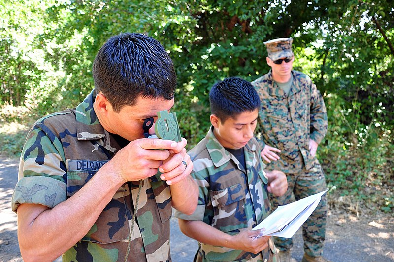 File:US Navy 111212-A-TF780-101 Sgt. Mark Miller observes Salvadoran Marines as they use a lensatic compass to help them complete a land navigation cour.jpg