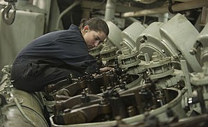 US Navy 120124-N-PB383-327 Engineman Fireman Recruit Megan Cotrell conducts maintenance on an engine in one of the main spaces aboard the amphibiou.jpg