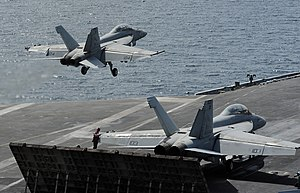 US Navy 120216-N-VO377-386 An F-A-18F Super Hornet assigned to the Bounty Hunters of Strike Fighter Squadron (VFA) 2 launches from the flight deck.jpg