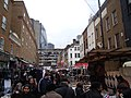 View of the Gherkin and buildings on Middlesex Street from Petticoat Lane Market - geograph.org.uk - 1704240.jpg