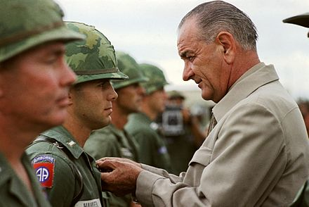 Awarding a medal to a U.S. soldier during a visit to Vietnam in 1966 Visit of President Johnson in Vietnam.jpg