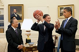 Wang Qishan - Wang Qishan holding a basketball in the Oval Office with U.S. President Barack Obama