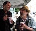 Wiener Tafel 20100618 340 aftermath - M. Haiderer (left, chairman of 'wiener tafel' joking with musician R. Neuwirth.jpg