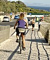 Woman on a bike (50223374357).jpg