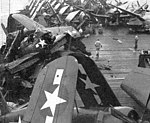 Wrecked aircraft on USS Attu (CVE-102) after typhoon in June 1945.jpg
