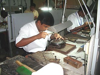 Lapidary - A jewellery worker in Sri Lanka (2006 photograph)