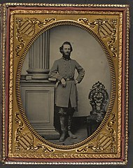 (Colonel Felix L. Price of Co. I, 14th Georgia Infantry Regiment, in uniform and CS buckle with books) (LOC) (14562241141).jpg