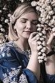 День Вишиванки. Молода україночка у вишитій синій сукні серед квітів 03.jpg