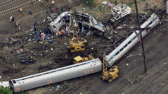 2015 Philadelphia train derailment - Aerial view of the wreckage after the crash, showing the first three of the seven passenger cars.