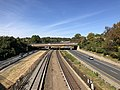2018-10-25 11 32 42 View west along Interstate 66 (Custis Memorial Parkway) and the Orange and Silver lines of the Washington Metro from the overpass for eastbound Virginia State Route 237 (Washington Boulevard) in Arlington County, Virginia.jpg