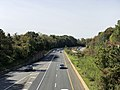 2018-10-25 12 11 24 View west along the eastbound lanes of Interstate 66 (Custis Memorial Parkway) and the Orange and Silver lines of the Washington Metro from the overpass for George Mason Drive in Arlington County, Virginia.jpg