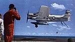 A-1J Skyraider of VA-215 landing aboard USS Hancock (CVA-19), in 1963.jpg