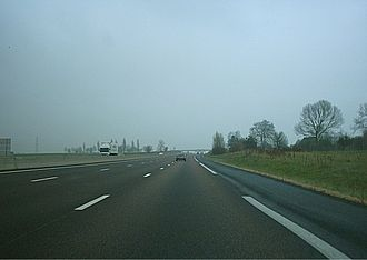 A13 autoroute - The A13 Eastbound between exits 25 and 26. The motorway has 3 lanes both directions.