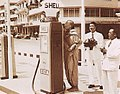 A Buddhist monk blesses a newly opened Shell station in Thailand in 1954 for prosperity.jpg
