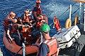 A Coast Guard crewmember aboard the Coast Guard Cutter Galveston Island (WPB 1349) prepares to assist U.S. Naval Sea Cadet Corps cadets disembark.jpg