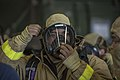 A Sailor dons a self-contained breathing apparatus. (13154128273).jpg