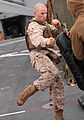 A U.S. Marine with Security Cooperation Task Force Africa Partnership Station 2012 practices a round kick while conducting Marine Corps Martial Arts Program training aboard the amphibious dock landing ship USS 120714-M-JU449-214.jpg