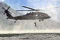 A U.S. Service member with Joint Task Force-Bravo jumps from a U.S. Army UH-60 Black Hawk helicopter during helocast training at Lake Yojoa, Honduras, Feb. 25, 2014 140225-F-BZ556-016.jpg