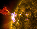 A burst of solar material leaps off the left side of the sun.jpg