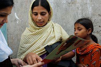 BRAC (NGO) - A BRAC community health worker conducting a survey in the Korail slum, Bangladesh