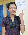 A first time voter showing mark of indelible ink after casting her vote, at a polling booth, during the 8th Phase of General Elections-2014, in Hamirpur, Himachal Pradesh on May 07, 2014.jpg