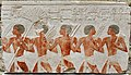 A group of Egyptian soldiers and Nubian mercenaries holding axes and branches of olives. From the mortuary temple of Hatshepsut at Deir el-Bahari, 15th century BCE. Neues Museum, Berlin.jpg