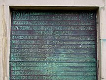 a discoloured brass plaque showing the names of those local men killed in the First World War