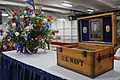 A memorial box prepared for the family of U.S. Navy Aviation Structural Mechanic Airman Apprentice Matthew Snow is displayed aboard the aircraft carrier USS George Washington (CVN 73) April 18, 2013, at Naval 130418-N-TP877-003.jpg