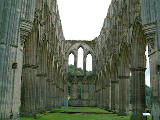Rievaulx Abbey, confiscated by Henry VIII along with its blast furnace at Laskill Abbey Church at Rievaulx.jpg