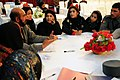 Afghan National Police (ANP) members have a round table discussion during a police female recruiting conference (4329927151).jpg