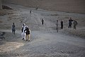 Afghan civilians walk to the site of a medical civic action program (MEDCAP) conducted by U.S. Soldiers Aug 26, 2013, in Logar province, Afghanistan 130826-A-YX345-079.jpg