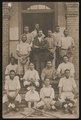 African American baseball team posing on front steps of building LCCN2015649999.tif