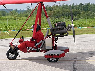 Rotax 503 - Air Creation Racer ultralight trike with Rotax 503 mounted up-right. Below the muffler is the smaller after-muffler.
