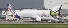 Outsized transport aircraft unloads an A320 fuselage part at Hamburg Finkenwerder Airport