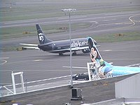 The alaskaair.com and Spirit of Disneyland planes together at PDX
