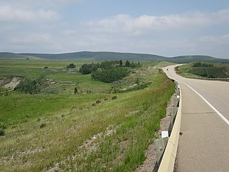 Alberta Highway 1A - Looking east along the Bow Valley Trail crossing the Grand Valley Creek about 8 km west of Cochrane