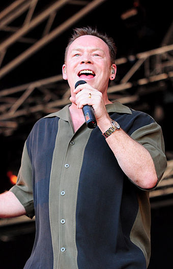 UB40's former frontman Ali Campbell performing in 2009. Ali Campbell at Raggamuffin 2009 cropped.jpg