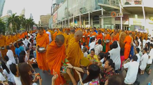 Alms giving to several thousand monks in Bangkok.