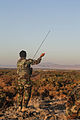 An Afghan National Army commando with the 1st Tolai, 3rd Special Operations Kandak sets up an antenna during a clearing operation in the Shah Wali Kot district of Kandahar province, Afghanistan, Nov. 11, 2013 131111-A-XP635-076.jpg