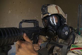 Battle of Mosul (2016–2017) - An Iraqi soldier during a course on chemical, biological, radiological and nuclear defense training at Camp Taji. Coalition forces have expressed fears ISIL may use chemical weapons during the Battle of Mosul.