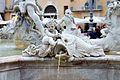 Angel with fish in the fountain of Neptune in Piazza Navona in Rome.jpg