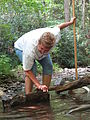 Ann McGhee turning stream rocks (4977014899).jpg