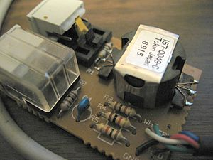 AppleTalk - Image: Apple Local Talk box interior 2 auto termination switch