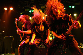 Heavy metal subculture - Death metal band Asphyx headbanging during a performance.