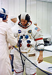 Astronaut Alan B. Shepard Jr., commander Apollo 14, undergoes suiting up.jpg