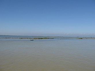 Haor - Alir Haor in Sunamganj District. The Khasi Hills in Meghalaya are faintly visible on the horizon.