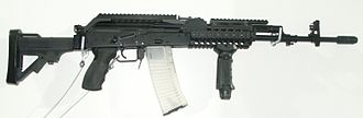 FB Beryl - wz.2004 Beryl with railed forend, vertical forward grip and receiver Picatinny rail (modified version of the wz. 96 Beryl)