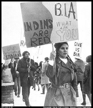 A group of NIYC demonstrators holding signs in front of the BIA office.